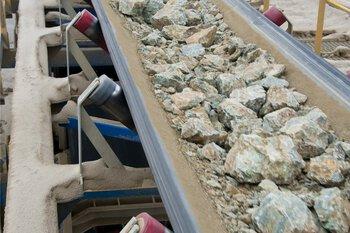 Conveyor belt with rocks at a mine