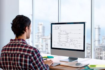 Man at a PC comparing the planned field devices and those actually installed