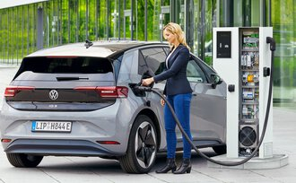 Woman charging an electric car