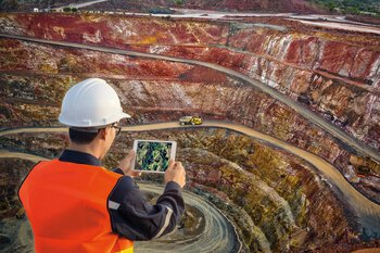 Man with tablet at a mine
