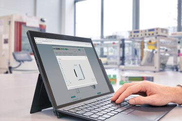 Hand on a laptop keyboard – screen with configurator open