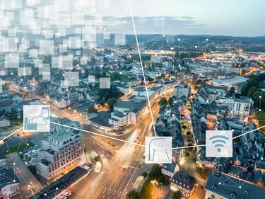 Bird's eye view of a city with icons for visualizing the networked transportation system in a Smart City